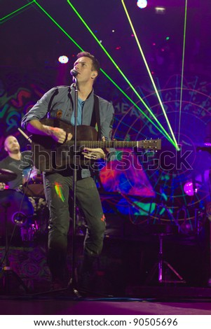 LONDON, UK - DECEMBER 10: Coldplay perform to a sellout crowd in Londons O2 Arena, on the December 10, 2011 in London, UK - stock photo