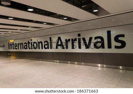 LONDON, UK - DECEMBER 30, 2012 : Inside Heathrow Airport Terminal 5 Arrivals on December 30, 2012 in London, England. London Heathrow Airport is the largest airport in the United Kingdom. - stock photo