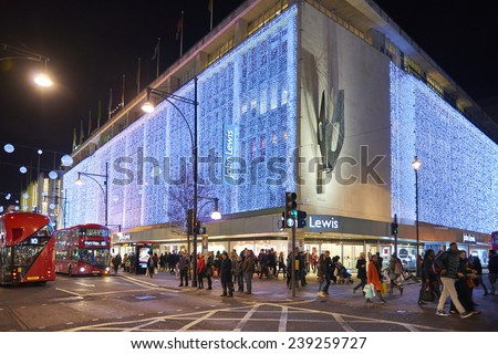 LONDON, UK - DECEMBER 20: Nighttime shot of John Lewis department store exterior in busy Oxford  street with wall of lights as part of its Christmas decorations. December 20, 2014 in London. - stock photo