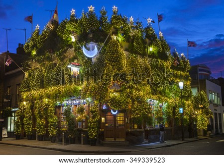 LONDON, UK - DECEMBER 9TH 2015: The Churchill Arms Public House decorated within an array of Christmas Trees to celebrate the festive season in Notting Hill, London on 9th December 2015. - stock photo