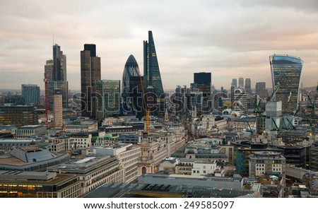 LONDON, UK - JANUARY 27, 2015: City of London, business and banking aria. London's panorama in sun set. View from the St. Paul cathedral - stock photo