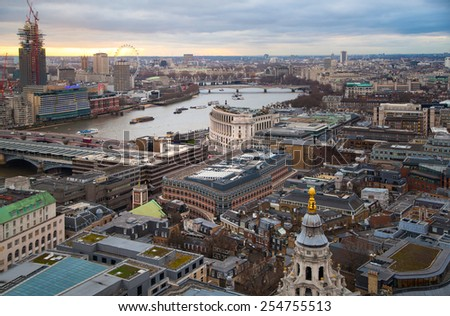 LONDON, UK - JANUARY 27, 2015: London bridge and Thames river in sun set. View from the St. Paul cathedral - stock photo