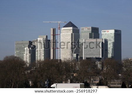 LONDON, UK - January 7 2015 - Mid Afternoon view of Canary Wharf London taken from the opposite side of the river Thames - stock photo