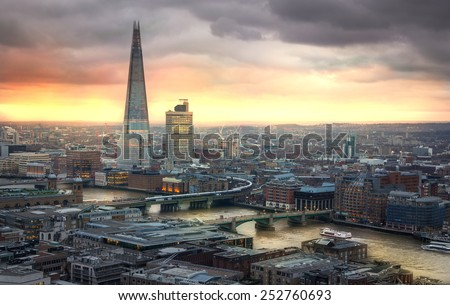 LONDON, UK - JANUARY 27, 2015: Shard of glass City of London, business and banking aria. London's panorama in sun set. View from the St. Paul cathedral - stock photo