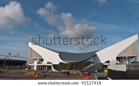 LONDON, UK -JANUARY 6:The Aquatic centre and Olympic stadium in the background, being prepared for The 2012 Olympic Games which will be held in the city of London, June 5, 2010, London, UK - stock photo