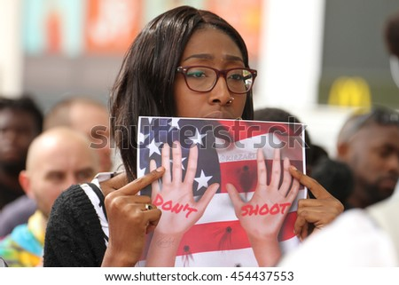 LONDON, UK - JULY 9 2016: A protestor seen holding a placard with the words 'Don't Shoot' at Windrush Square following the deaths of two black american men in the USA by police. - stock photo