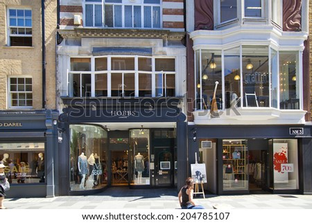 LONDON, UK - JULY 03, 2014: Bond street boutiques, street of famous small fashion businesses - stock photo