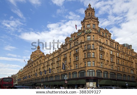 LONDON, UK - JULY 22: Harrods Department Store and traffic along Knightsbridge in Kensington on July 22, 2011 in London, UK. Harrods is the most famous department store in the world. - stock photo