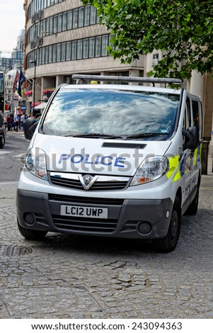 LONDON, UK - JULY 1, 2014: London Metropolitan Police vehicle in the City of London. The Met was formed in 1829 and as of 2011 employed 48,661 staff making it one of biggest employers in London. - stock photo