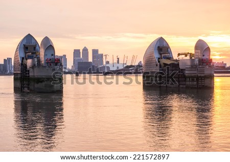 London, UK -26 July 2014: London's flood barrier on river Thames and Canary Wharf - stock photo