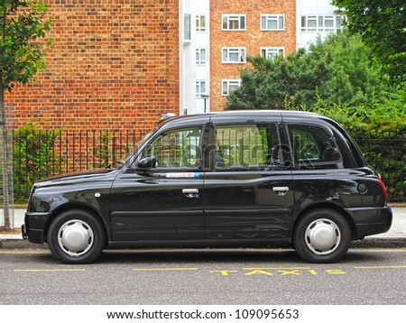 LONDON, UK - JULY 16: LTX4 Hackney Carriage, typical London Taxi / Black Cab on July 16, 2012, London, UK. LTX4 is manufactured only by the The London Taxi Company. Black taxis are symbol of London. - stock photo