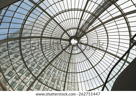 LONDON, UK - JULY 3, 2014: Modern glass architecture of Canary Wharf bunnies district. Shopping mall - stock photo