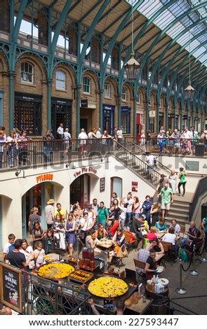 LONDON, UK - 22 JULY, 2014: Paella in Covent Garden market, one of the main tourist attractions in London, known as restaurants, pubs, market stalls, shops and public entertaining. - stock photo