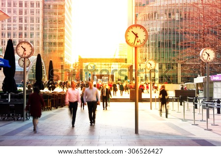 LONDON, UK - JULY 03, 2014: People walking to get to work at early morning in Canary Wharf aria - stock photo