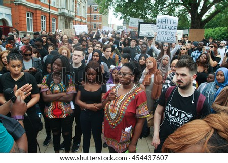 LONDON, UK - JULY 9 2016: Protestors at Windrush Square  as they prepare to march in Brixton for a solidarity march following the shooting of Alton Sterling and Philando Castile by poilice in the USA - stock photo