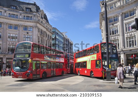 LONDON, UK - JULY 29, 2014: Regent street in London, tourists and busses - stock photo
