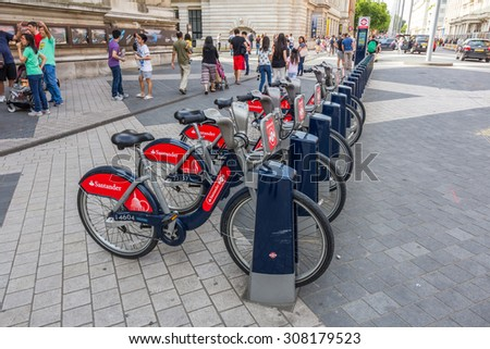 LONDON, UK - JULY 20, 2015: Santander bicycle station in London, UK. Bicycles are one of the best way to explore London. - stock photo