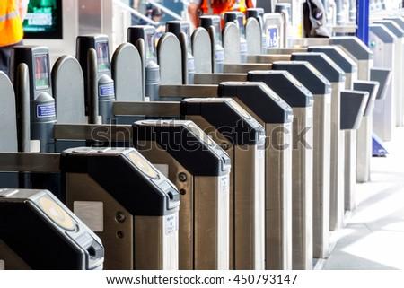 London, UK - July 5, 2016 - Ticket gates in Kings Cross train station - stock photo