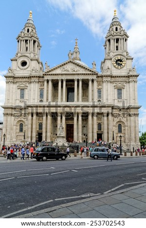 LONDON, UK - JULY 1, 2014: Tourists in front of the St. Paul Cathedral. The cathedral was the tallest building in London from 1710 to 1962. - stock photo