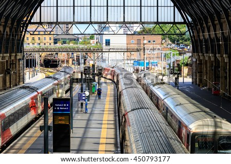 London, UK - July 5, 2016 - Trains stop at the platforms in Kings Cross train station - stock photo