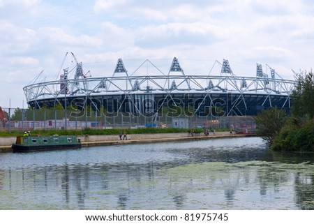 LONDON, UK-JULY 31: View of the Olympic Stadium from Hackney Wick across the canal. The Olympic park is under construction for the London 2012 Olympic Games, Stratford. July 31, 2011 in London UK - stock photo
