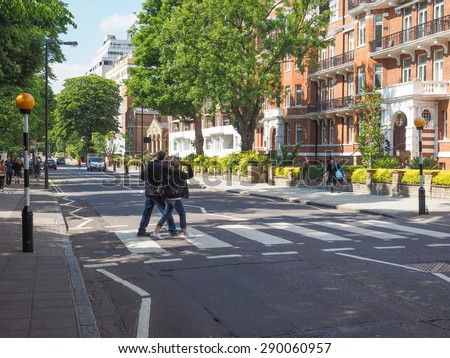 LONDON, UK - JUNE 10, 2015: Abbey Road zebra crossing made famous by the 1969 Beatles album cover - stock photo