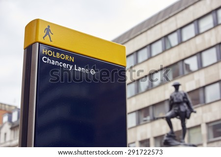 LONDON, UK - JUNE 23: Chancery Lane Station sign with war memorial in the background. June 23, 2015 in London. - stock photo