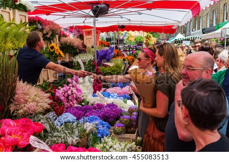 London, UK - June 19, 2016: Columbia Road Flower Market with unidentified people. It is a popular historic street market in the London Borough of Tower Hamlets. - stock photo