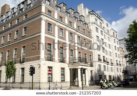 LONDON, UK - JUNE 28, 2014: Diplomatic Protection Officers outside the Embassy of the Peoples' Republic of China in London. - stock photo