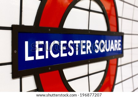 LONDON, UK - JUNE 3, 2014 - Leicester Square Underground Tube sign. Symbol of a well visited tourist destination in the city of London - stock photo