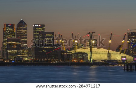 LONDON, UK - JUNE 06, 2015: Millennium Dome at night, view across river Thames. It was built to house an exhibition celebrating the beginning of the third millennium. It's now a key feature of The O2 - stock photo