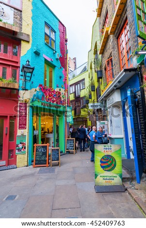 London, UK - June 16, 2016: Neals Yard with unidentifed people. It is a small alley in Covent Garden with colorful houses. It contains several health food cafes and values driven retailers - stock photo