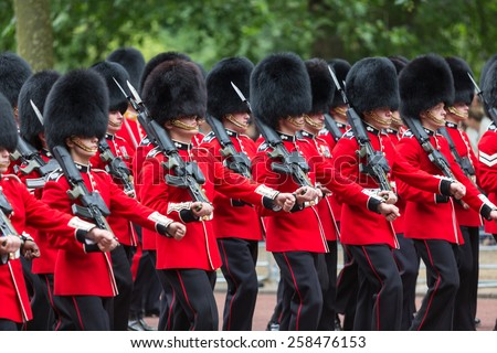 LONDON, UK - JUNE 14: Queen's guards with a rifle on his shoulder, on June 14, 2014 in London. - stock photo