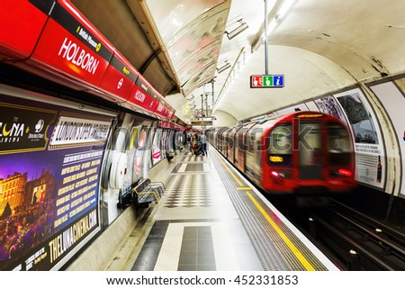 London, UK - June 19, 2016: red double decker bus in motion blur in London night traffic. The famous red buses are one of the main iconic symbols of London. - stock photo