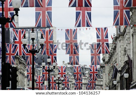 LONDON, UK, JUNE 1: Regent Street is decorated with Union Jack flags to celebrate the Queen's Diamond Jubilee on June 1, 2012 in London. The main celebrations will be held  from June 2 to June 5. - stock photo