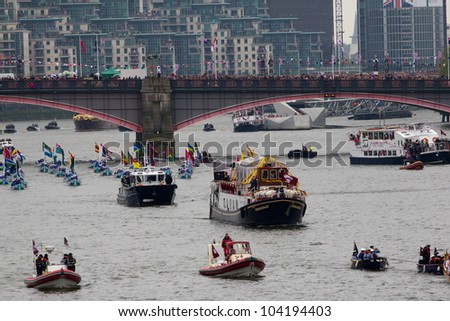 LONDON, UK - JUNE 03: 1000 Ships and boats travel along the River Thames In celebration of the Queens Diamond Jubilee on the June 03, 2012 in London, UK - stock photo