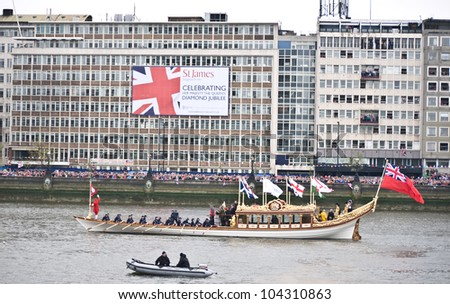 LONDON,UK-JUNE 3: Sir Steve Redgrave and Sir Matthew Pinsent help row the Gloriana the Royal Rowbarge, commissioned as tribute to the Queen,in the Diamond Jubilee Pageant. June 3, 2012 in London UK - stock photo