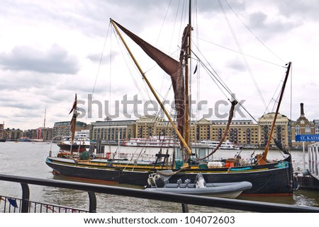 LONDON,UK-JUNE 1:Sprit sail barge May built in 1891, moored at St Katherine's Pier in the Avenue of sails. part of the Queen's Diamond Jubilee Pageant on the Thames. June 1, 2012 in London UK. - stock photo