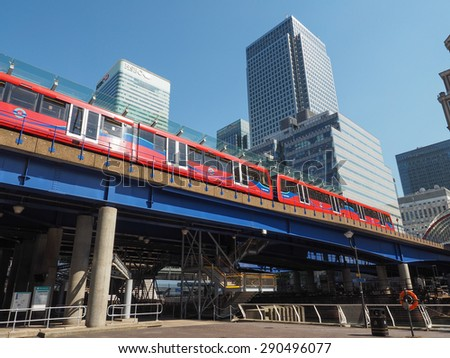 LONDON, UK - JUNE 11, 2015: The DLR meaning Docklands Light Railway links the docks redevelopment area in East London with the city centre - stock photo