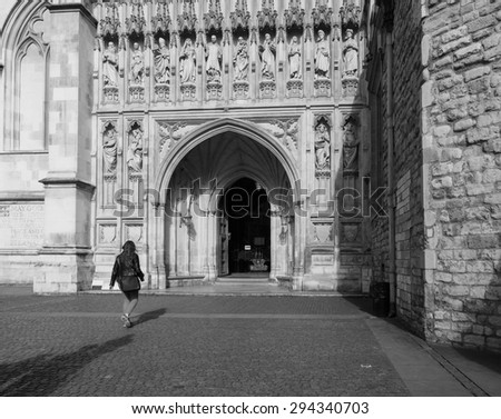 LONDON, UK - JUNE 09, 2015: Tourists visiting Westminster Abbey church in black and white - stock photo