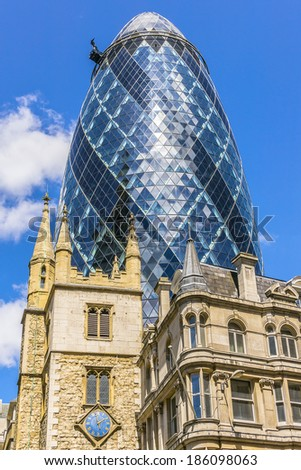 LONDON, UK - JUNE 3, 2013: View of Gherkin building (or 30 St Mary Axe, 2004) in London. Gherkin - iconic symbol of London, one of city's most widely recognized examples of modern architecture. - stock photo