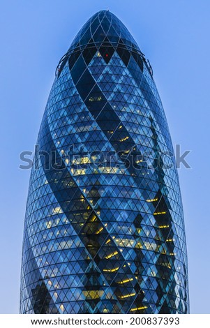LONDON, UK - JUNE 3, 2013: View of Gherkin building (30 St Mary Axe) at night. Gherkin - iconic symbol of London, one of city's most widely recognized examples of modern architecture. - stock photo