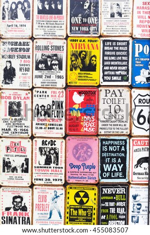 London, UK - June 19, 2016: vintage enamel signs at an antique shop at the Portobello Road in Notting Hill. The road is a tourist attraction for its street market with second hand clothes and antiques - stock photo