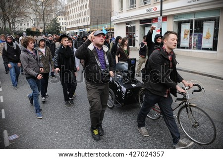 London, UK - March 26, 2011: A breakaway group of protesters march through the streets of the British capital during a large anti cuts rally. - stock photo