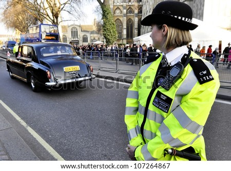 LONDON, UK - MARCH 12: A police woman outside Westminster Abbey where Queen Elizabeth II attends the Commonwealth Day ceremony on March 12, 2012 in London, UK. - stock photo