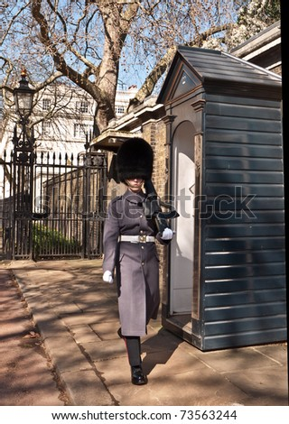 LONDON, UK - MARCH 19: A Soldier marches by the sentry box,outside the Royal residence of The Prince of Wales at Clarence House. March 19, 2011 in London UK. - stock photo