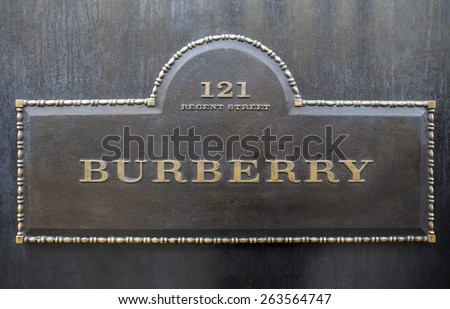 LONDON, UK - MARCH 22ND 2015: A sign for the Burberry clothing store on Regent Street in London on 22nd March 2015. - stock photo