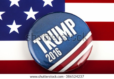 LONDON, UK - MARCH 3RD 2016: A Trump 2016 pin badge over the US flag symbolizing the Donald Trump campaign to become the next President of the United States, 3rd March 2016. - stock photo