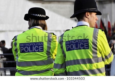 LONDON, UK - MARCH 12: Two police officers outside Westminster Abbey where Queen Elizabeth II attends the Commonwealth Day ceremony on March 12, 2012 in London, UK. - stock photo