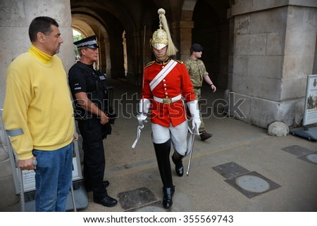 LONDON, UK - MAY 30, 2015: A member of the Horse Guard takes part in changing of the guard at Horse Guard Parade in Westminster. - stock photo